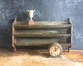 Grungy Small Metal Shelf Wood Sides