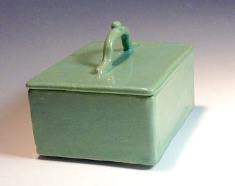Green lidded storage container