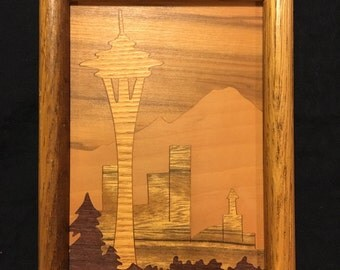 Wood inlay Seattle scene.