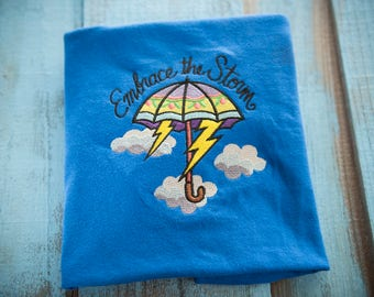 Embrace the storm shirt - Umbrella t-shirt - Weather tshirt - Rain top - Rainbow lightning thunder shirt - embroidered umbrella clouds shirt