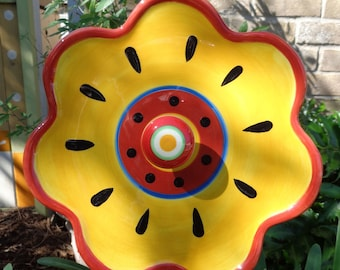 Yellow trimmed in Red Plate Flower