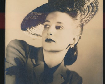 original fashion photo of a model in a tilt hat, suit, and black gloves, 8 x 10, 1940's