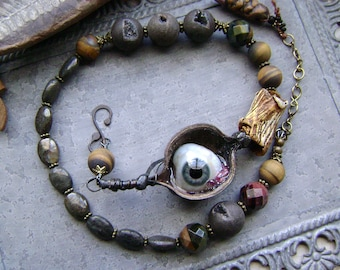 prosthetic eye asymmetrical assemblage necklace with natural stones and artisan ceramics, oddities, curiosities, seedpods, AnvilArtifacts