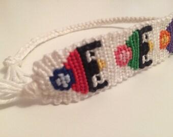 Handmade Penguins in PomPom Hats Embroidery Floss Friendship Bracelet