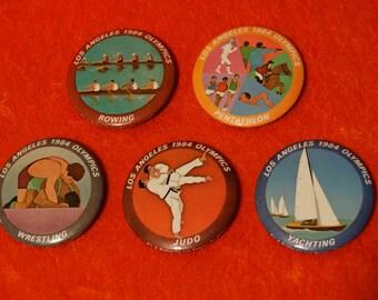 Lot of 5 Vintage 1984 Los angeles LA Olympic Buttons Judo Wrestling Rowing Yachting Pentathlon