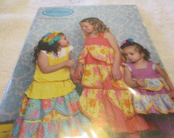 Paper Pattern for a kati cupcake dress, top, and skirt pattern called Princess Regan in sizes 12 months-10