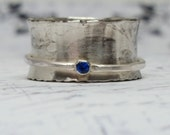 Sterling silver spinner ring with brilliant faceted Blue Sapphire 2 mm worry ring fidget ring alternative wedding ring size 6