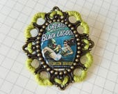 Creature from the Black Lagoon brooch embellished with yarn
