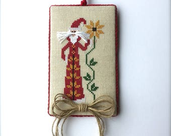 Completed primitive cross stitch Sunflower Santa Christmas ornament