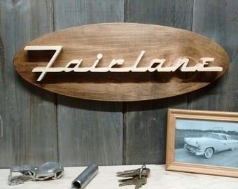 1956 Ford Fairlane Emblem Oval Wall Plaque-Unique scroll saw automotive art created from wood for your garage, shop or man cave.