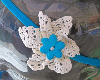 White Lace Flower with a Blue Flower Button Center on a Blue Headband (LH007)