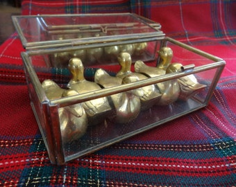 Brass duck napkin holder rings  - set of six - in a glass and brass box - vintage and hefty - get your ducks in a row