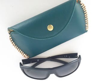Soleil Glasses Case:  Teal leather with metallic rose gold Kangaroo Lacing and forest bunny lining