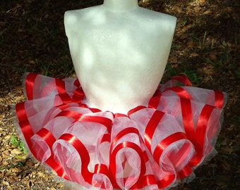 White tulle tutu with a red ribbon twist. Pretty peppermint, candy cane inspired skirt.