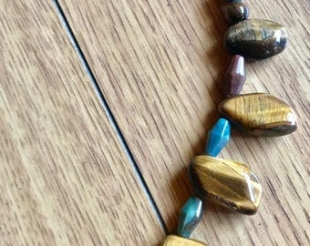 Mixed tiger eye necklace, featuring brown and gold tiger eye drop