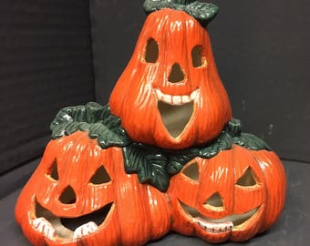 Painted pumpkin stack