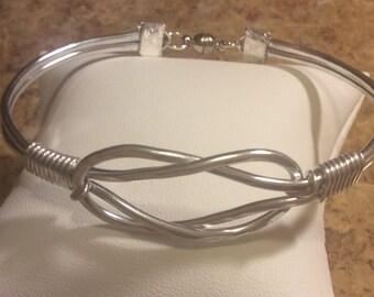 Hammered love knot cuff bracelet