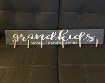 Grand kids make life more grand hand painted sign with clips for hanging art.