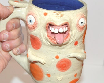 Goofy Faced Mug with bum on backside. Aprox. 16 oz stoneware. One of a kind. signed J Cotton