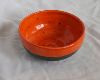 Small Bowl in Orange and Black with Small Black Dots on the Inside