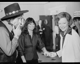 First Lady Rosalynn Carter with Waylon Jennings, smoking a cigarette, and Jesse Colter