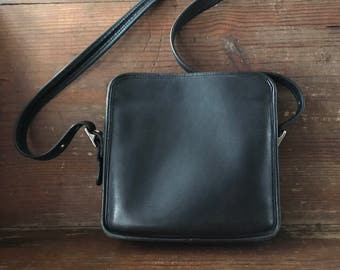 Vintage black leather Coach crossbody bag, made in USA, with nickel fittings