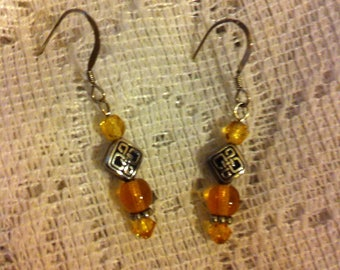 Honey gold and silver pierced earrings with Celtic knot beads