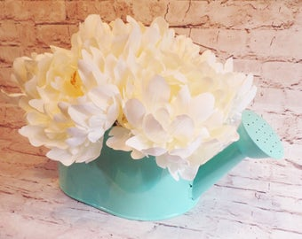 White Peonies Arranged in a Charming Blue Enameled Watering Can