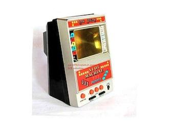Electronic game. Las vegas. Electronic toy. Casino. Gambling. Gambling gift. Slot machine. Arcade game. Vintage electronic slot machine toy.