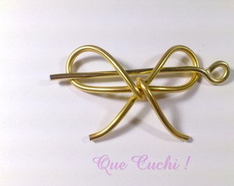 Bow Tie Barrette for the hair in golden aluminum