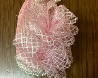 Pale pink and ivory fascinator