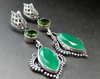 Silver earrings with jade and quartz.
