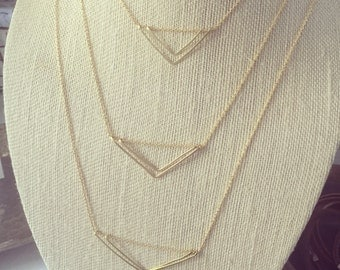 Hand formed, hammered, floating triangle necklaces hammered clasps using wire, leather and metal