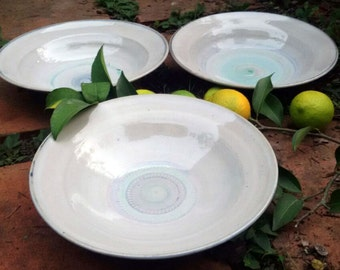 Hand thrown shallow ceramic bowl/soup bowl white glazed with delicate blue and Turq decoration