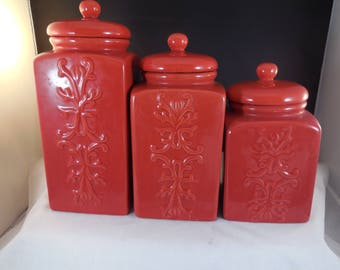 Red canister set of three, tall thin bright red vintage canister set.