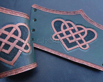Leather hand tooled short Bracers with a Celtic heart knot image in green and copper