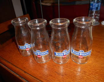 four Grade school size  Wells Blue Bunny half pint glass  milk bottles with wire wood handeled carrier