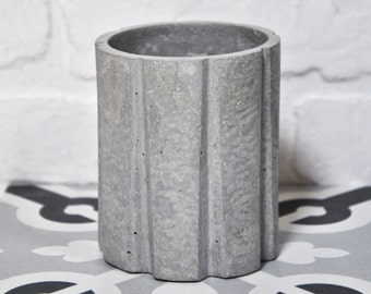 Fluted glass of concrete for the bathroom. Cement vase.