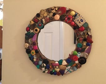 Mirror with earrings