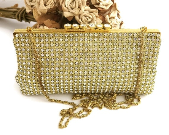 Rhinestone studded gold purse with gold engine turned frame with 6 enormous rhinestones on top, long link chain handle, circa 1960s