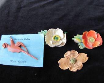 Four  Vintage wooden carved Pins