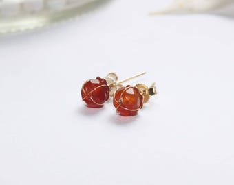 Gold plated stud earrings with cornaline stones