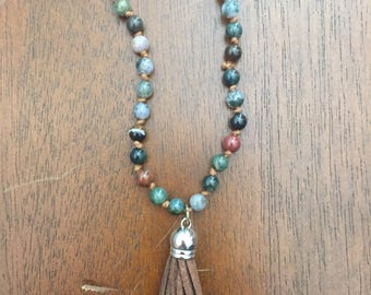Beaded necklace with brown tassel