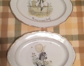 Holly Hobbie porcelain platters Holly Hobbie Happiness is having someone to care for Holly Hobbie To the house of a friend