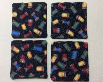 Quilted coasters, sewing motif.  Set of 4