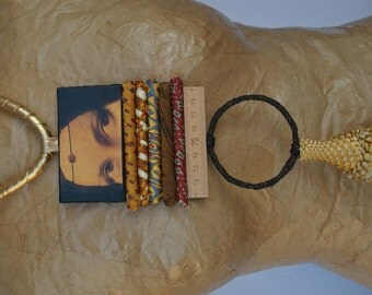Statement necklace golden textile with pendant with Leonardo da Vinci painting and tassel