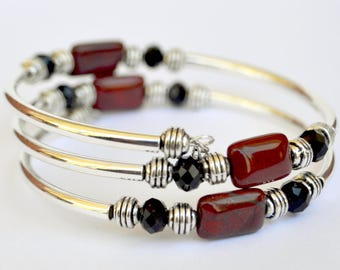 Red Rainbow Jasper natural gemstone bracelet with silver tubing and black faceted beads