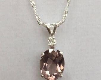 Natural pink tourmaline with diamond.