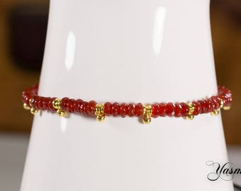 Faceted carnelian with gold-plated beads