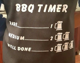 BBQ Timer Parody Funny Black Barbeque BBQ Apron White Font